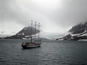 """The boat rocked, churned up by the waves from the avalanche the locals call """"white thunder""""."""